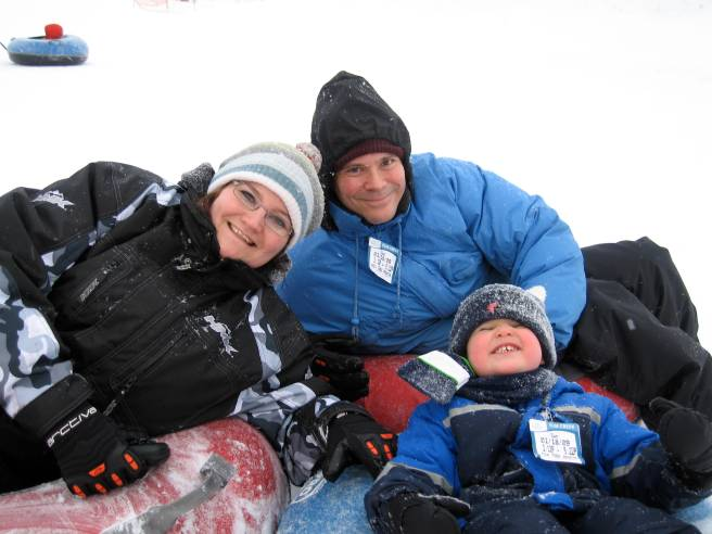 Me, Hubby & Punky on our snow tubes