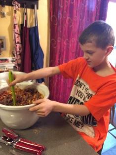 My sweet nephew making his Chili